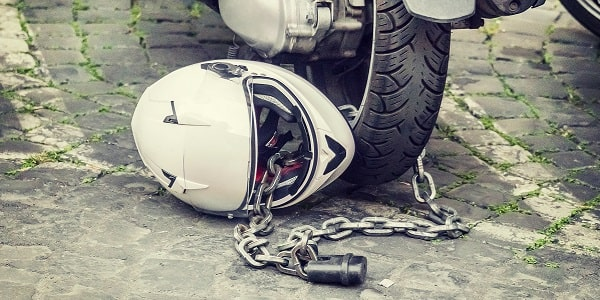motorcycle helmet chained to motorcycle