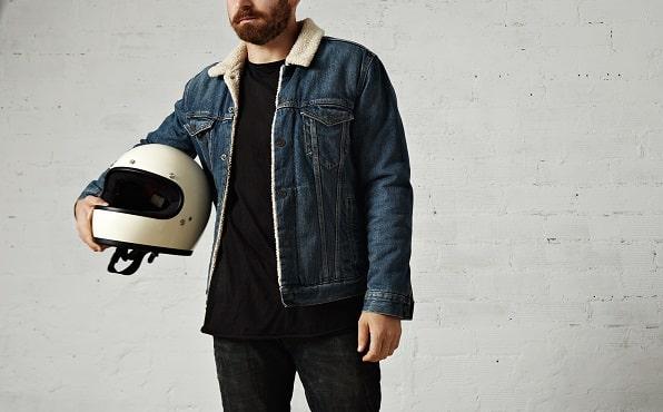 rider holding helmet