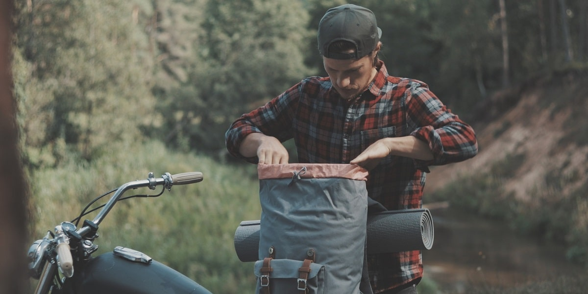 motorcyclist with camping gear