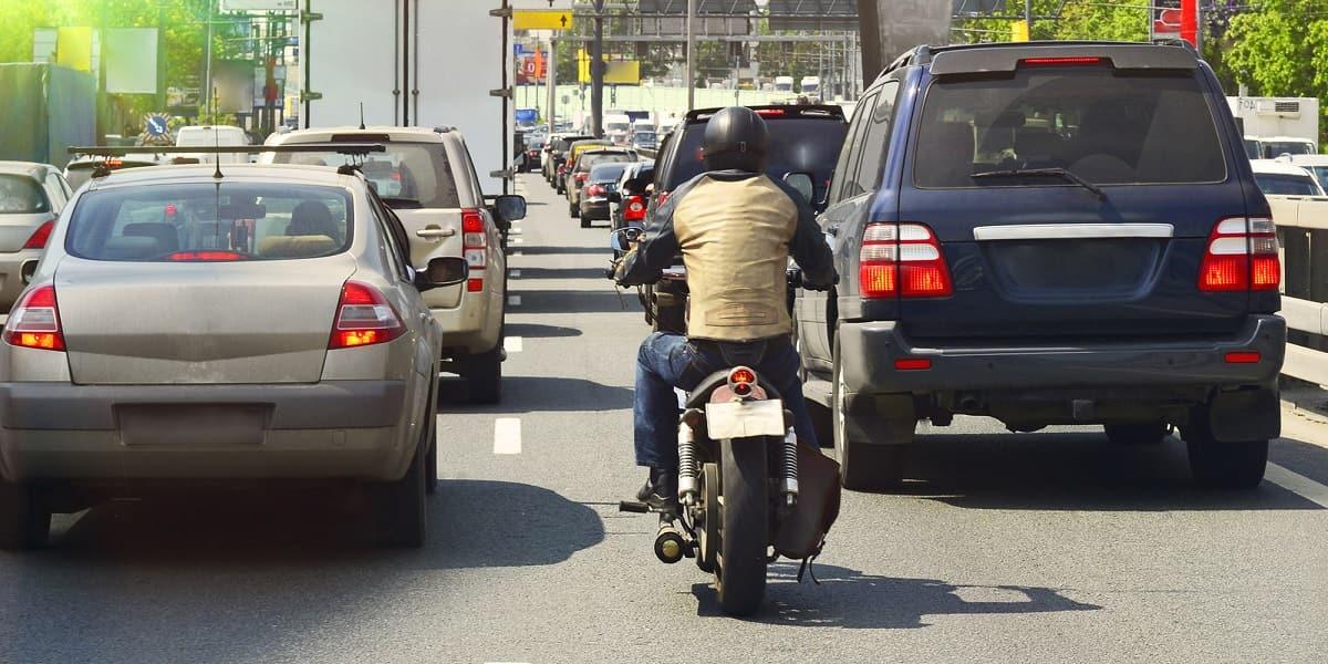 motorcyclist filtering in traffic