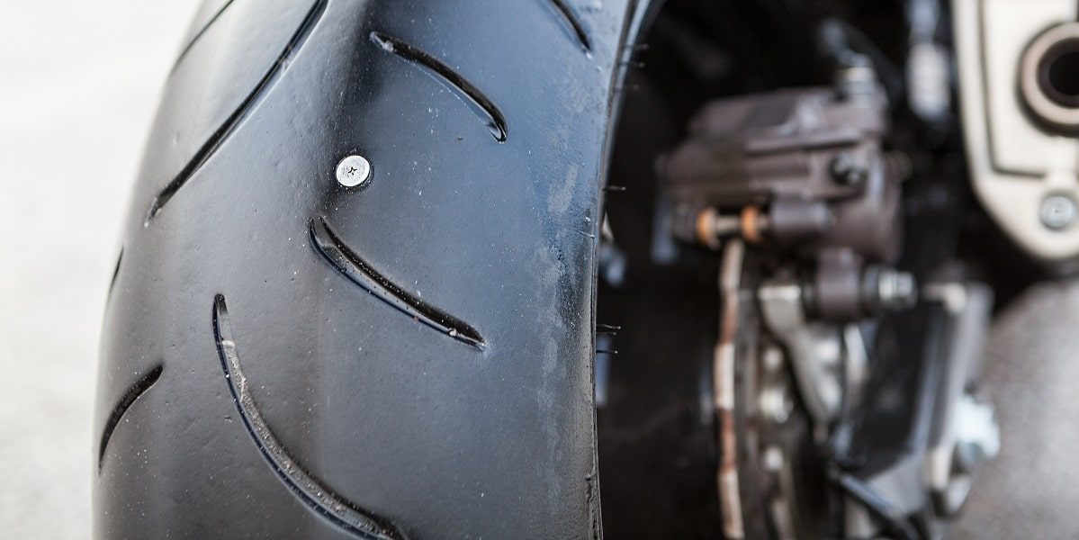 motorcycle tire with puncture