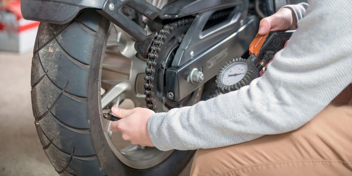 taking tire pressure on motorbike